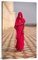 Online Designer Home/Small Office Indian woman in red dress walking by the Taj Mahal, Agra, India