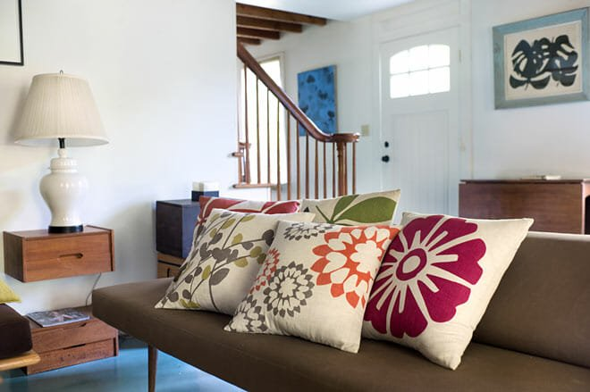 judy ross printed pillows in country house