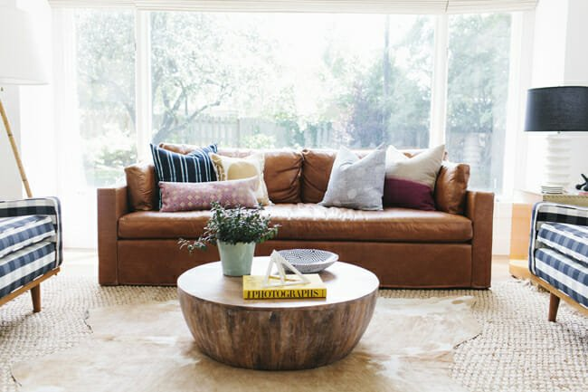 layering-rugs-cowhide-over-jute-Studio-McGee