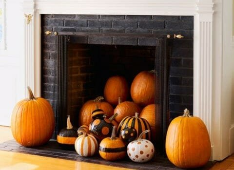 halloween decor trends fireplace pumpkins