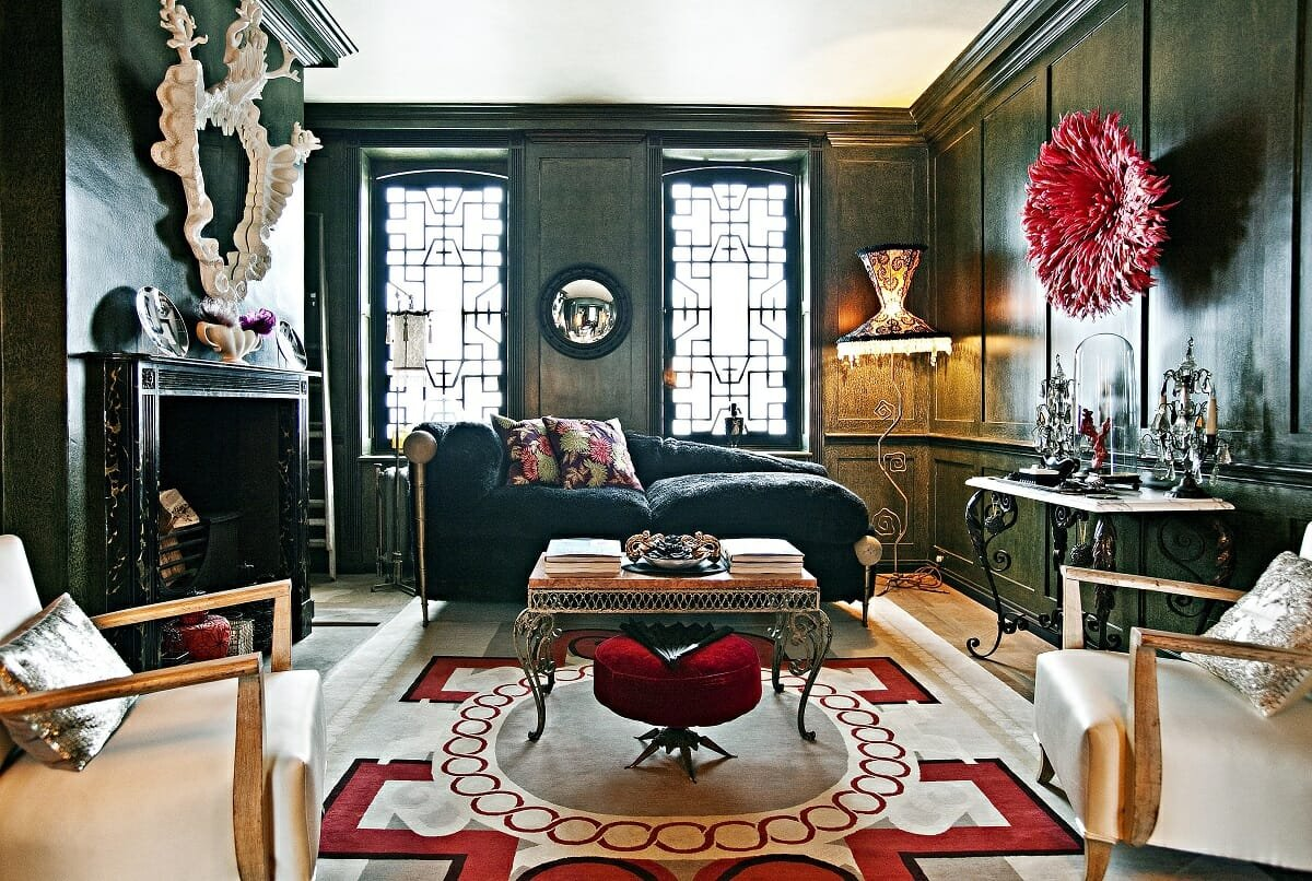 Eclectic interior with dark walls and statement artwork