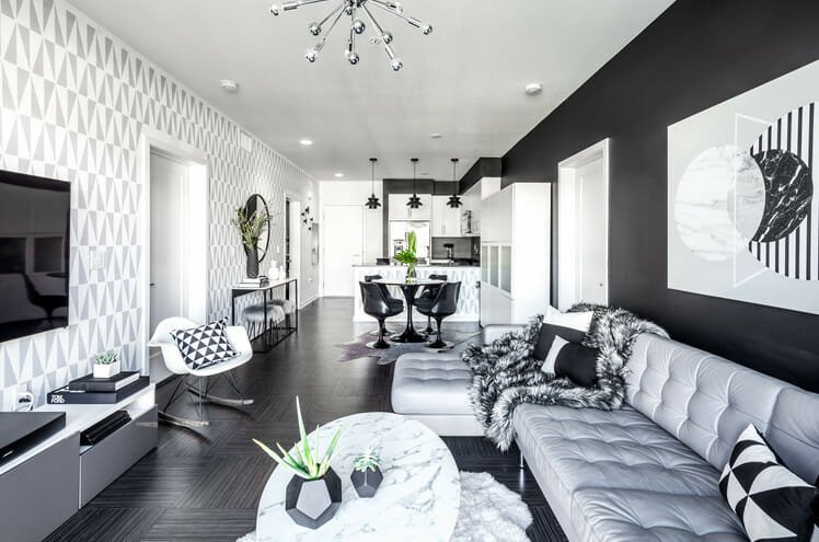 black and white living room decor with greenery