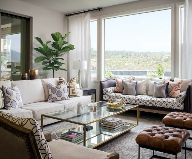 transitional white formal living room with traditional seating and geometric patterned scatter cushions