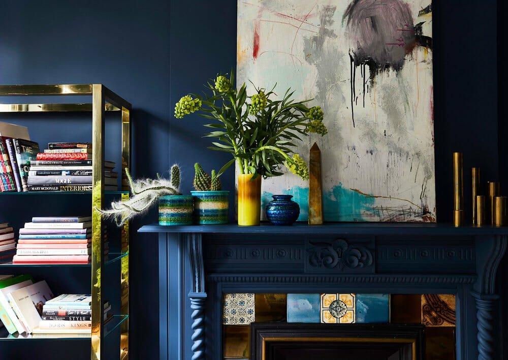 original art in a moody blue lounge
