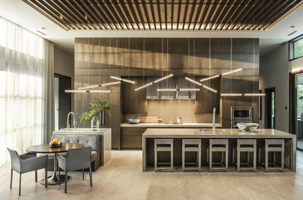 warm modern kitchen and dining by interior decorators in orlando ansana