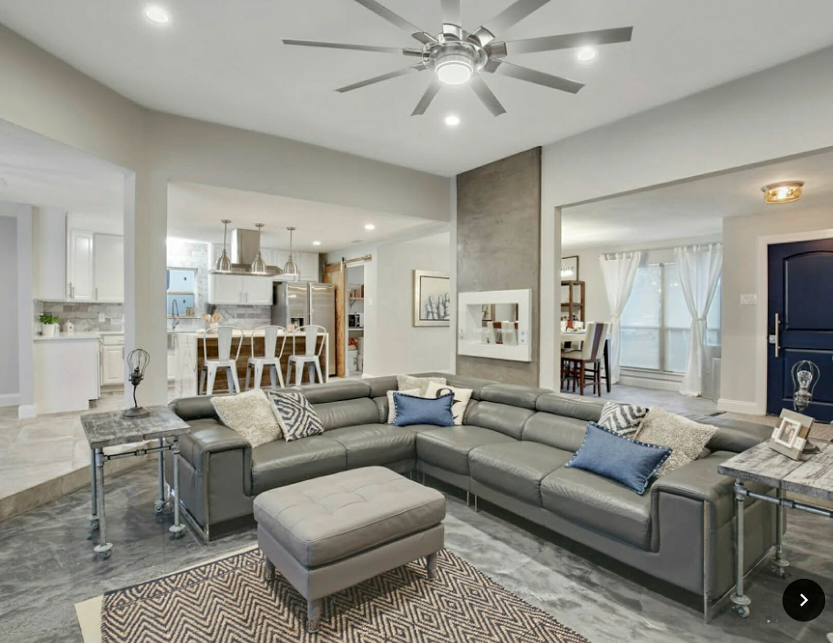 Contemporary open living room design by Decorilla home decorator in Dallas, Holly M.