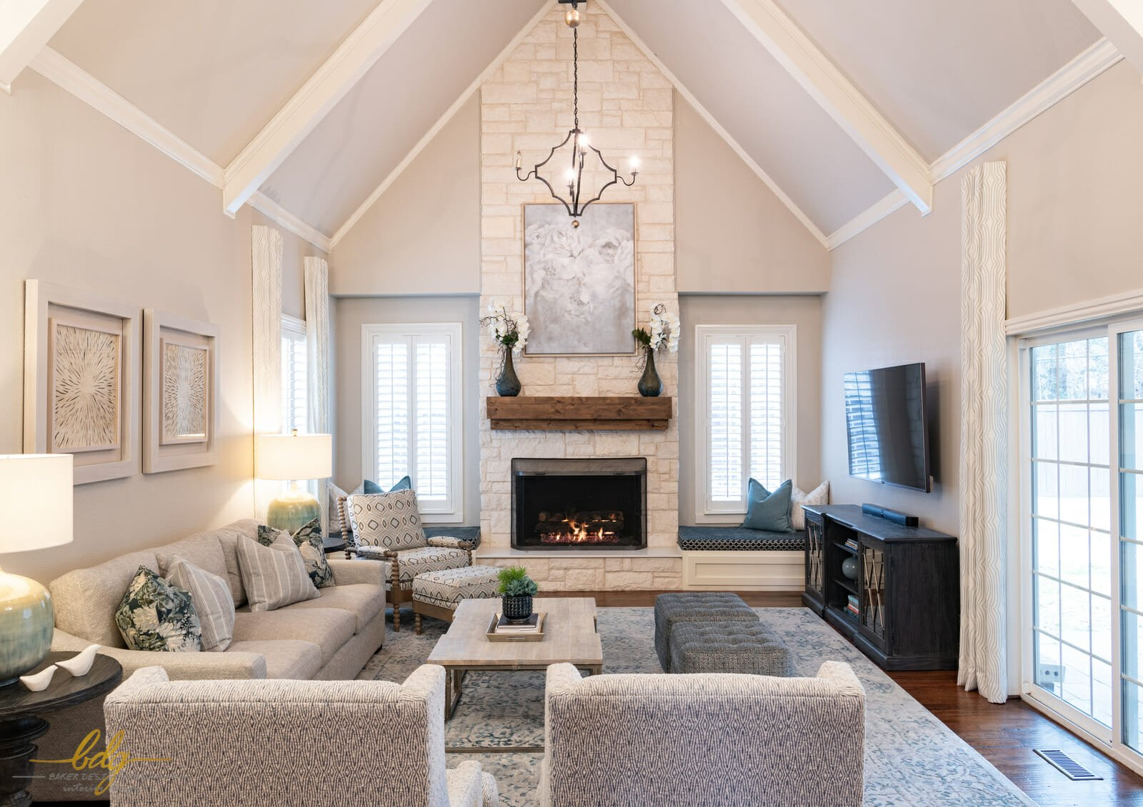 Transitional living room with fireplace by one of the best dallas interior designers