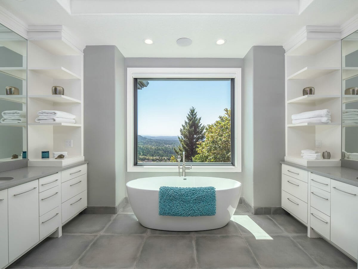 relaxing master bath with a view by interior decorators portland - allison smith design