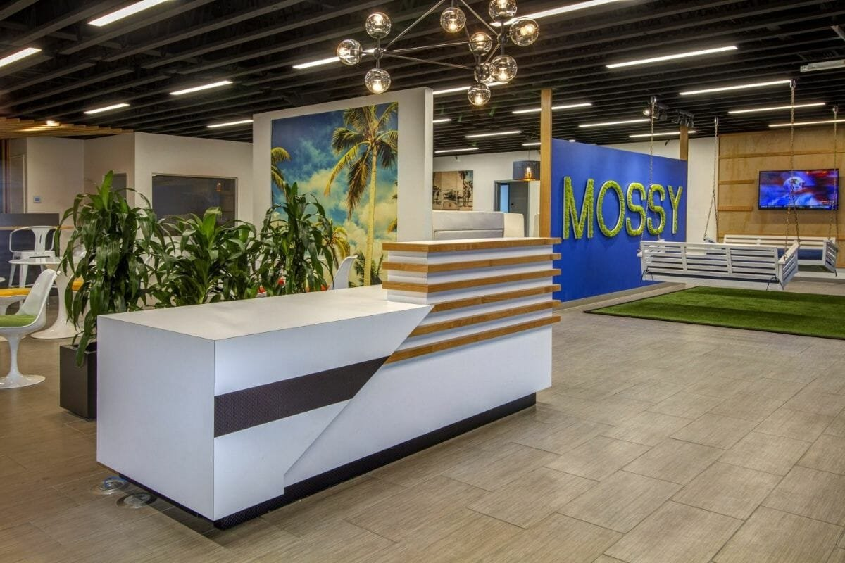 Office design in white, green and brown with moss
