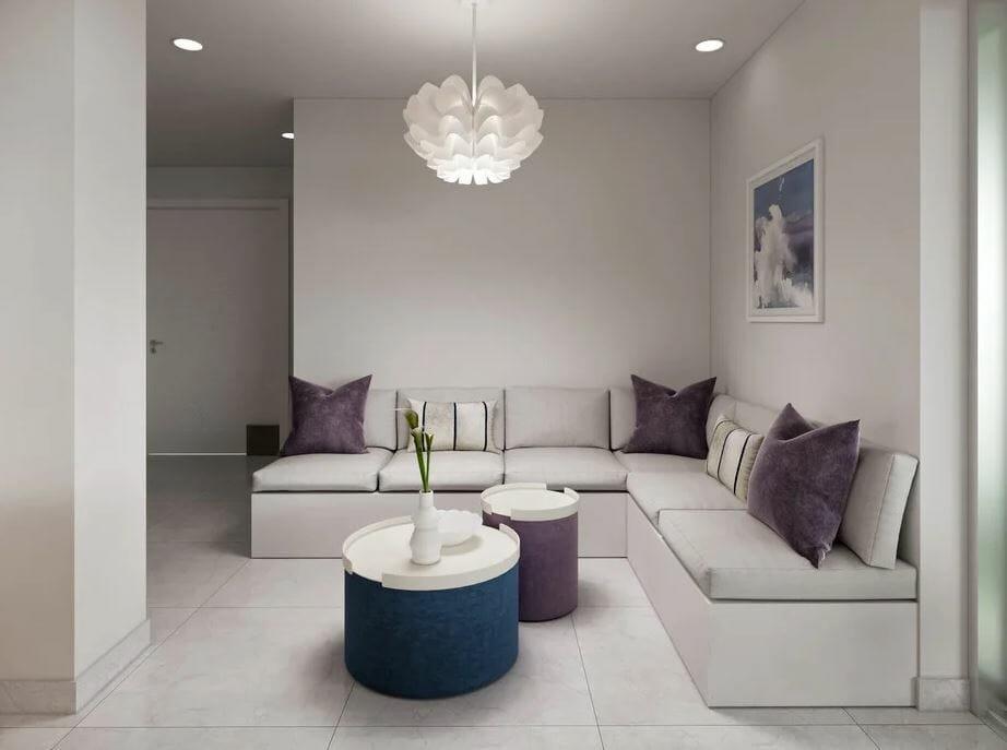 modern condo living room design with a contemporary light fixture