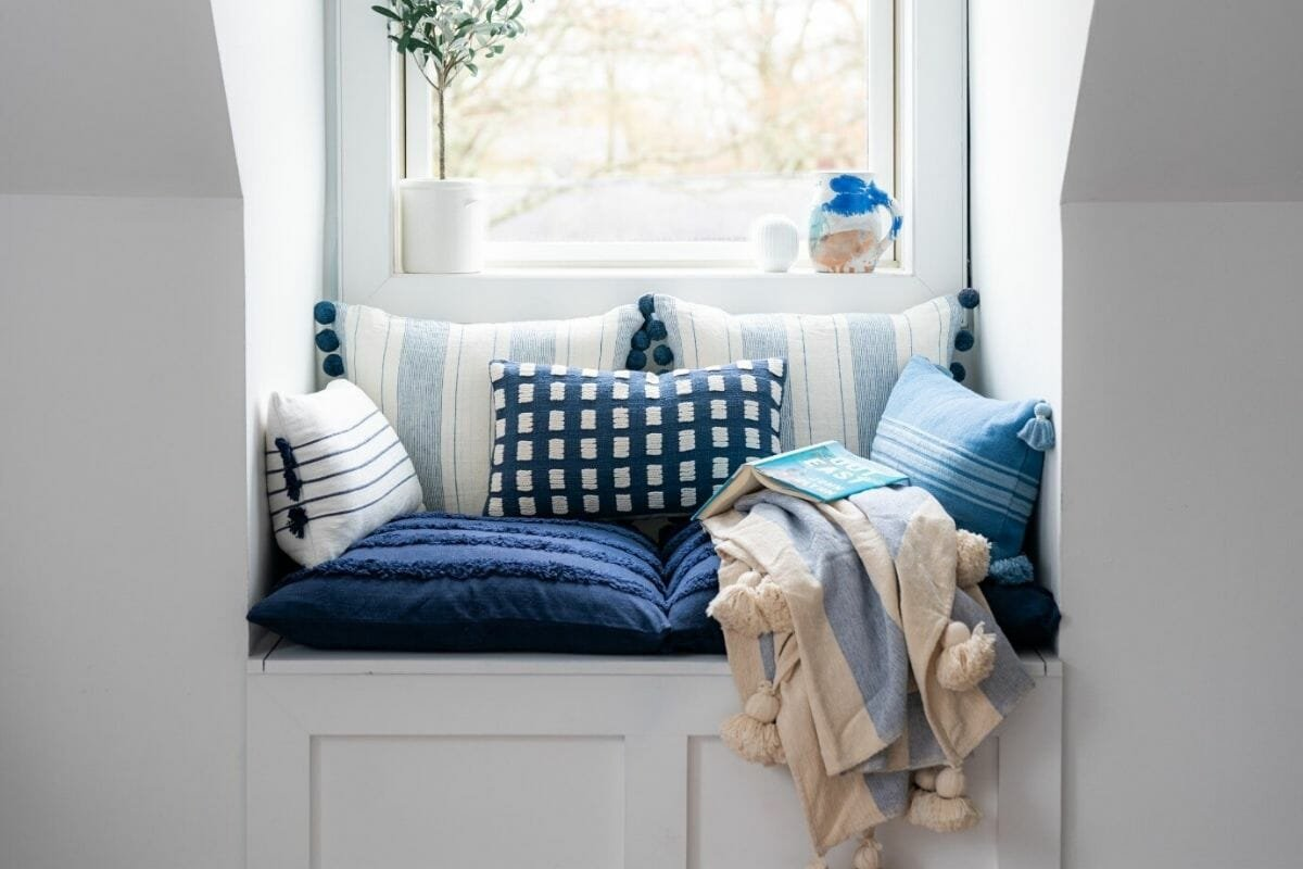 Calming reading nook in blue and white, perfect for a happy home design