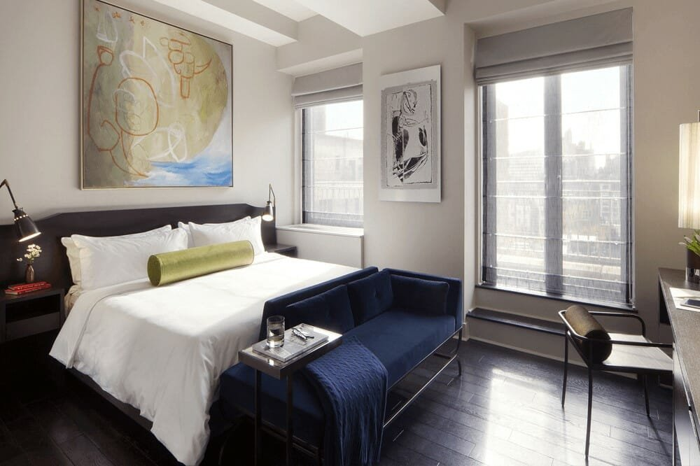 Contemporary bedroom in New York with blue and gold home decor accents