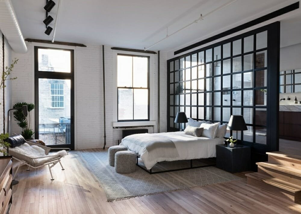 Contemporary industrial bedroom with monochromatic home decor in NYC