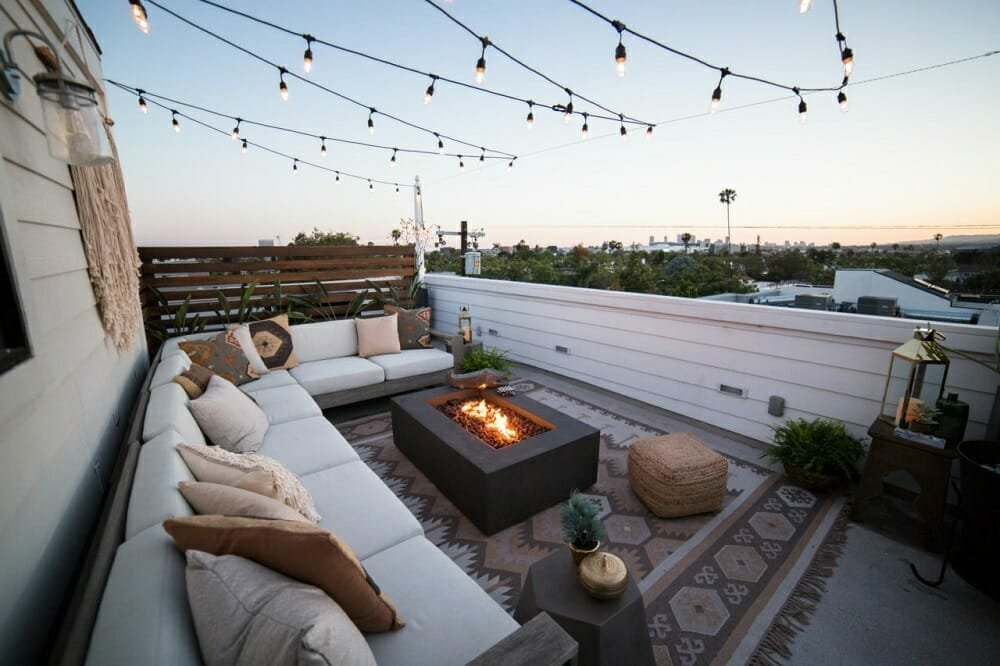 Beautiful rooftop patio design with a firepit