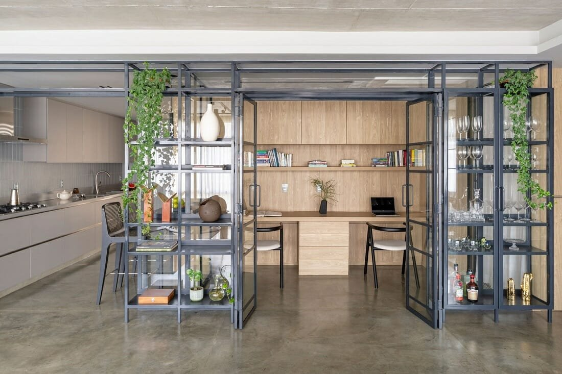 Home office next to the kitchen separated only by glass panels