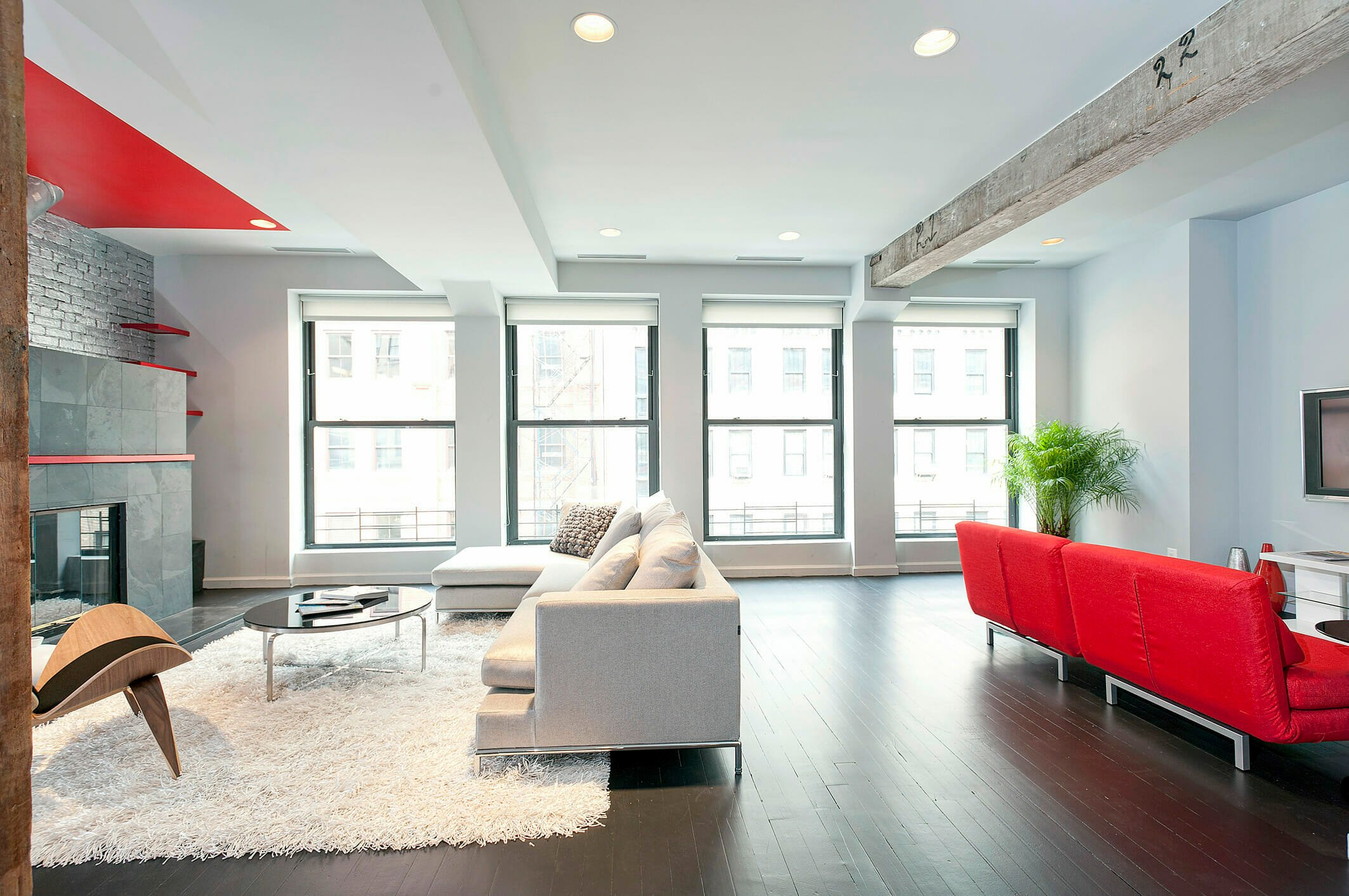 New York loft decorating style with pops of red