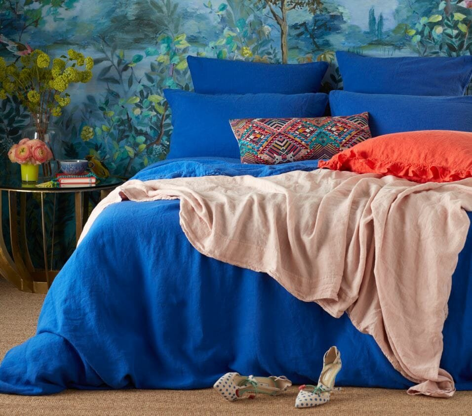 Blue bedroom with pops of orange styled by interior stylist Sophie Robinson