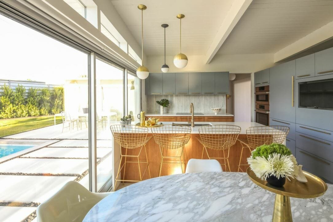 Bright and airy kitchen and dining room with a mid century interior design