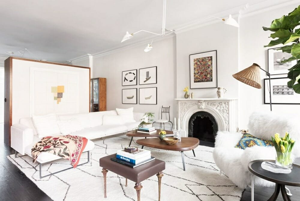 Contemporary eclectic living room by one of the top interior design companies, Amy Lau
