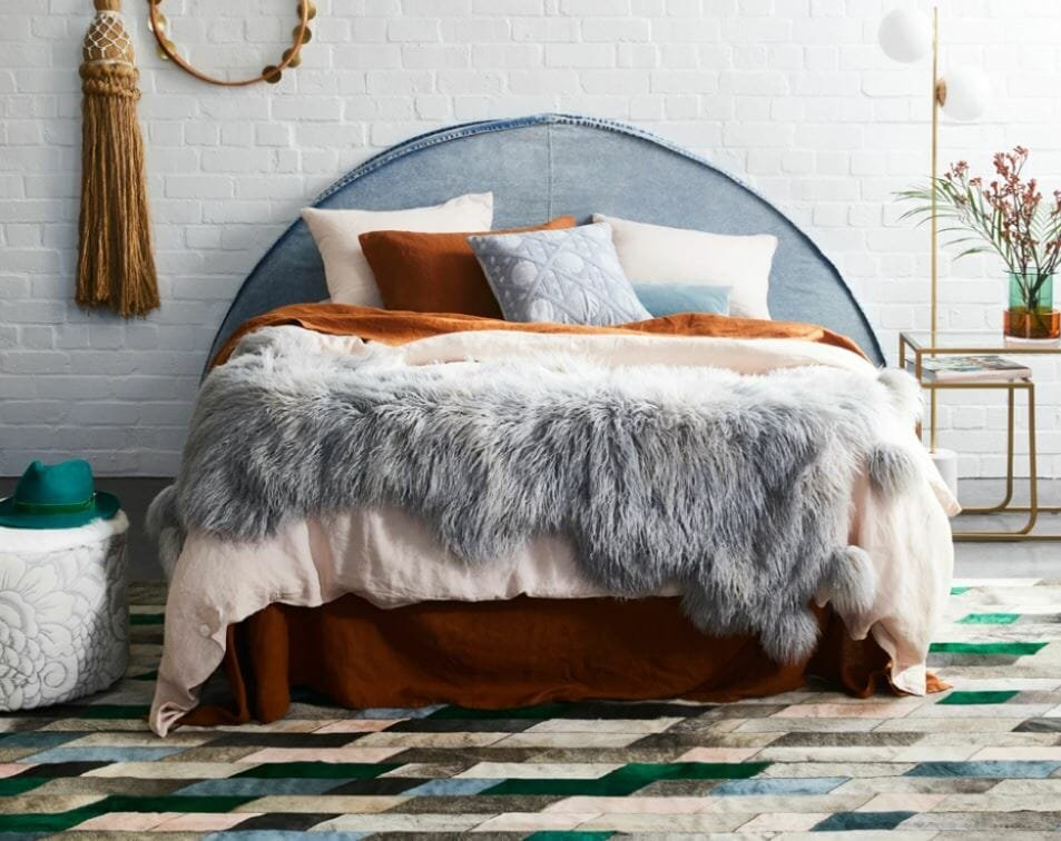 Cow hide rug styled in a desert bohemian bedroom by Julia Green