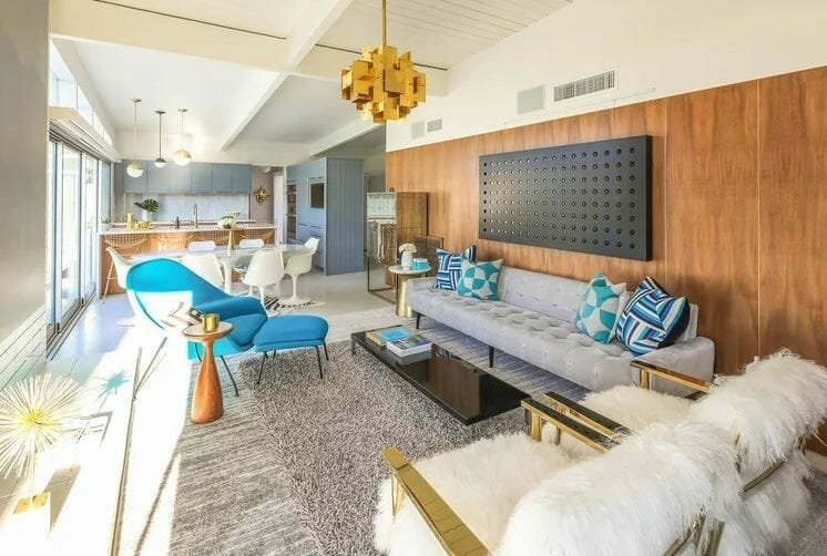 Mid century interior design living and dining area with blue and gold accents