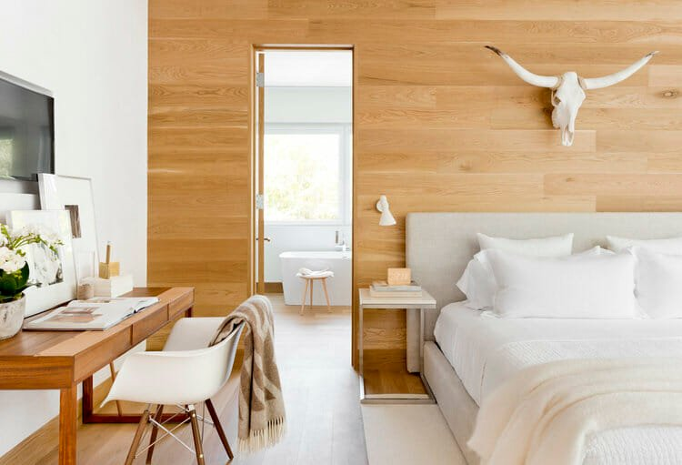 Neutral and light modern apartment design for a bedroom by Rikki