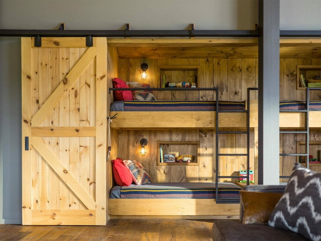Bunk beds behind sliding barn doors for a modern cabin interior