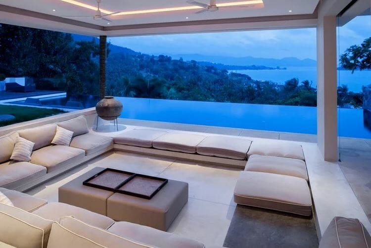 Luxury patio with a large seating area next to an infinity pool - a design a patio online result