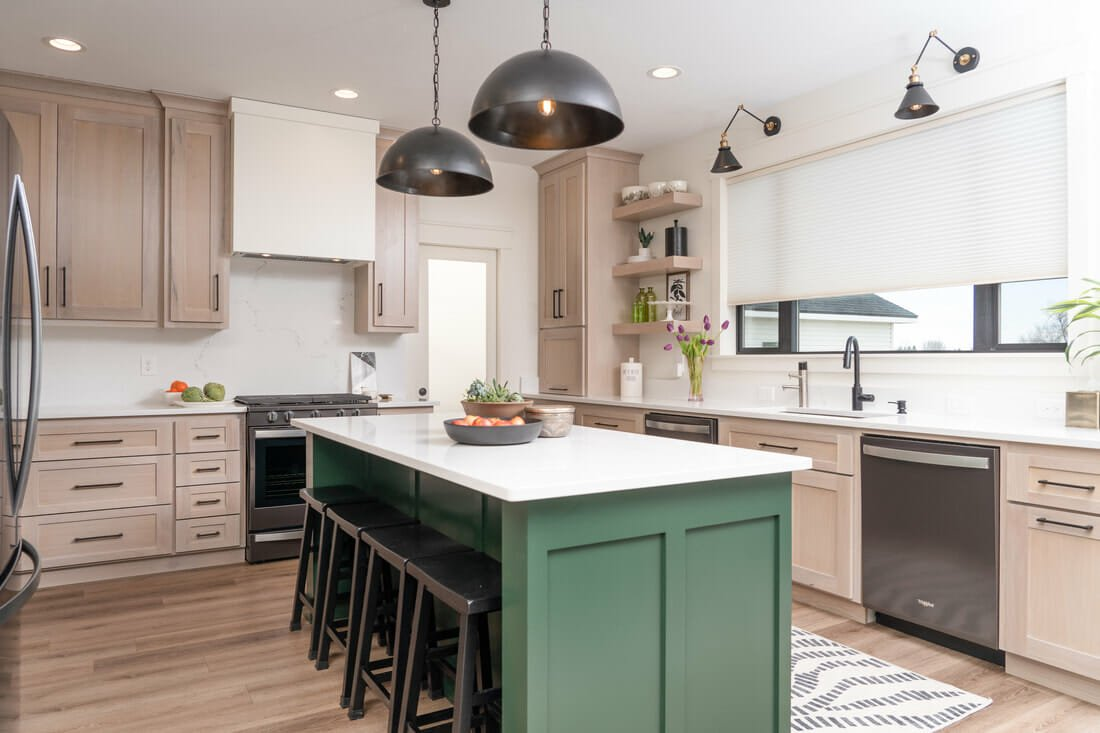 Cute kitchen design with a green kitchen island and black pendants by SBD - interior design gift certificate idea