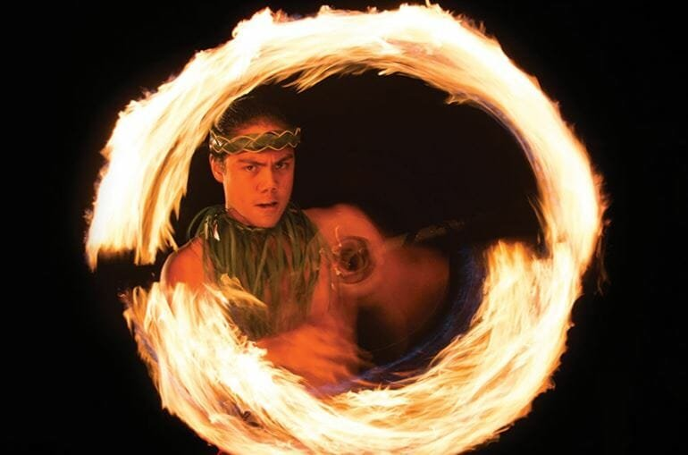Man spins fire as part of a show by Ticketmaster - among the best gift card ideas