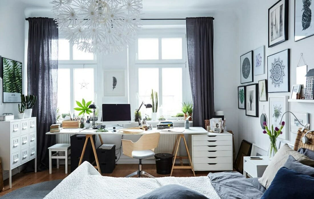 Scandinavian-inspired study area in a bedroom in greys and blues by iKea