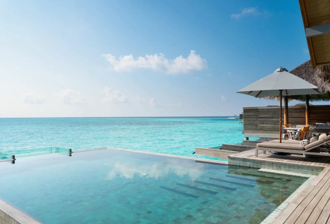 Swimming pool overlooking Maldive's tranquil waters, by Hotels.com - romantic gift card ideas for Valentine's Day
