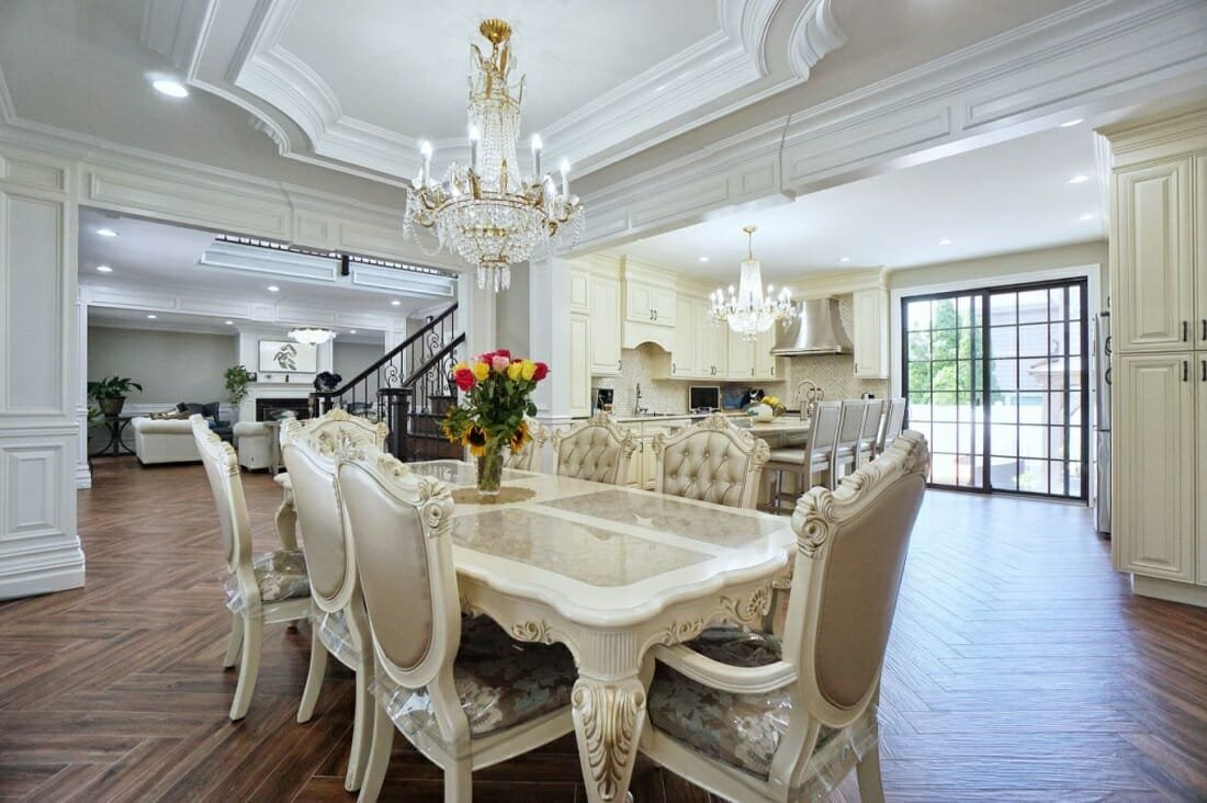 Traditional home style dining room with French Rococo tufted chairs and extendable table