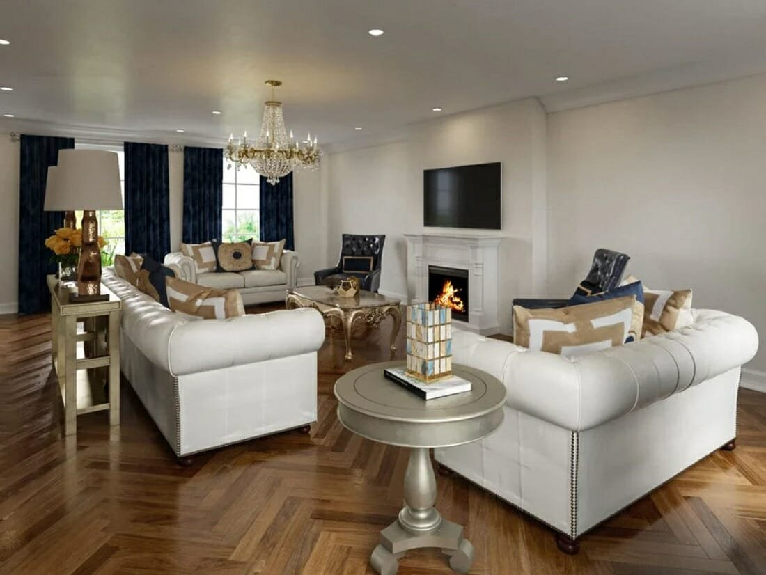 Traditional home style luxurious living room with white Chesterfield sofas and blue and beige accents