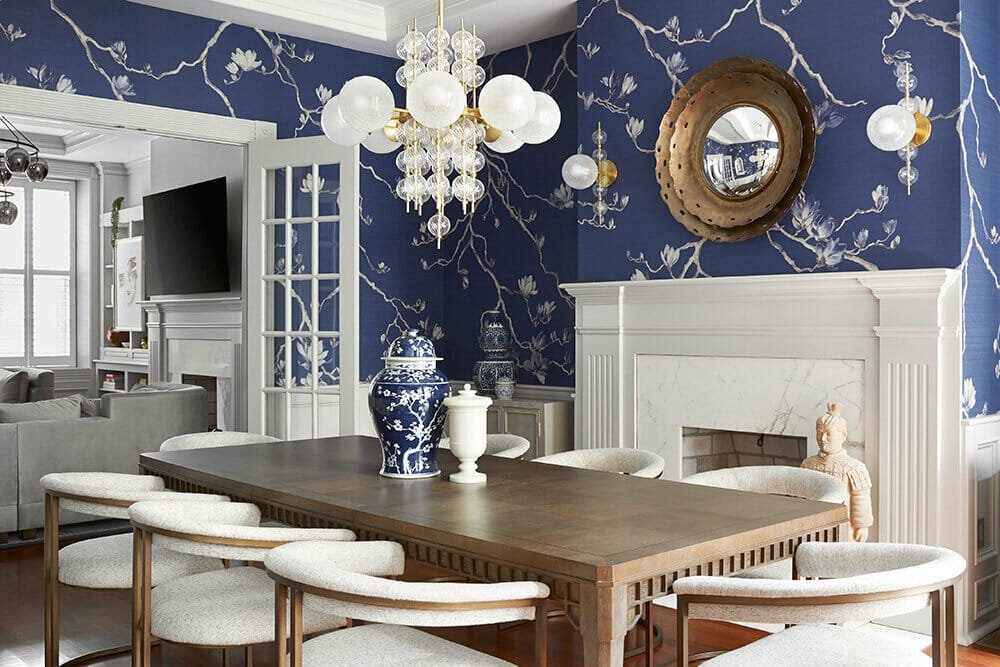 Electic contemporary dining room with a blue wallpaper by W+B - best interior designers in Philadelphia