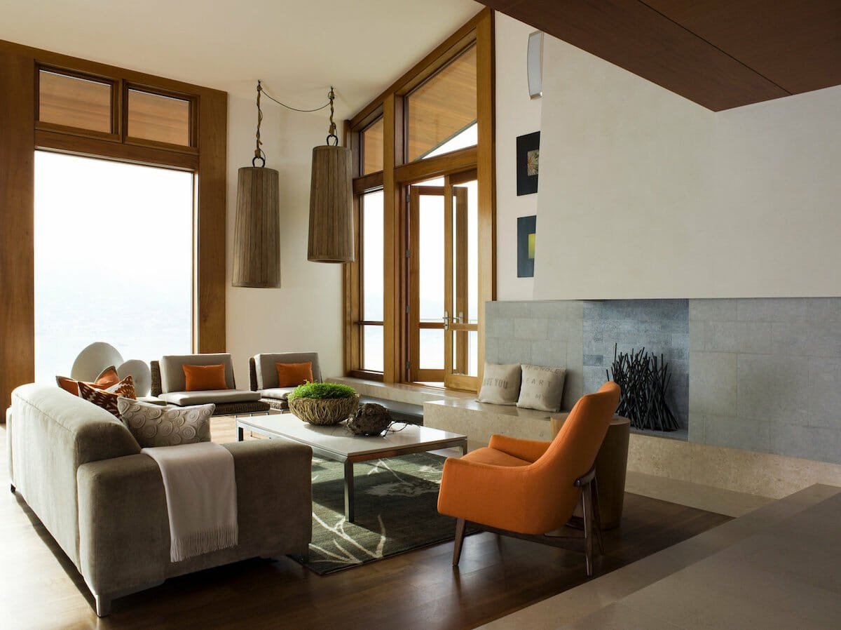Modern living room with burnt orange and brown fall color scheme