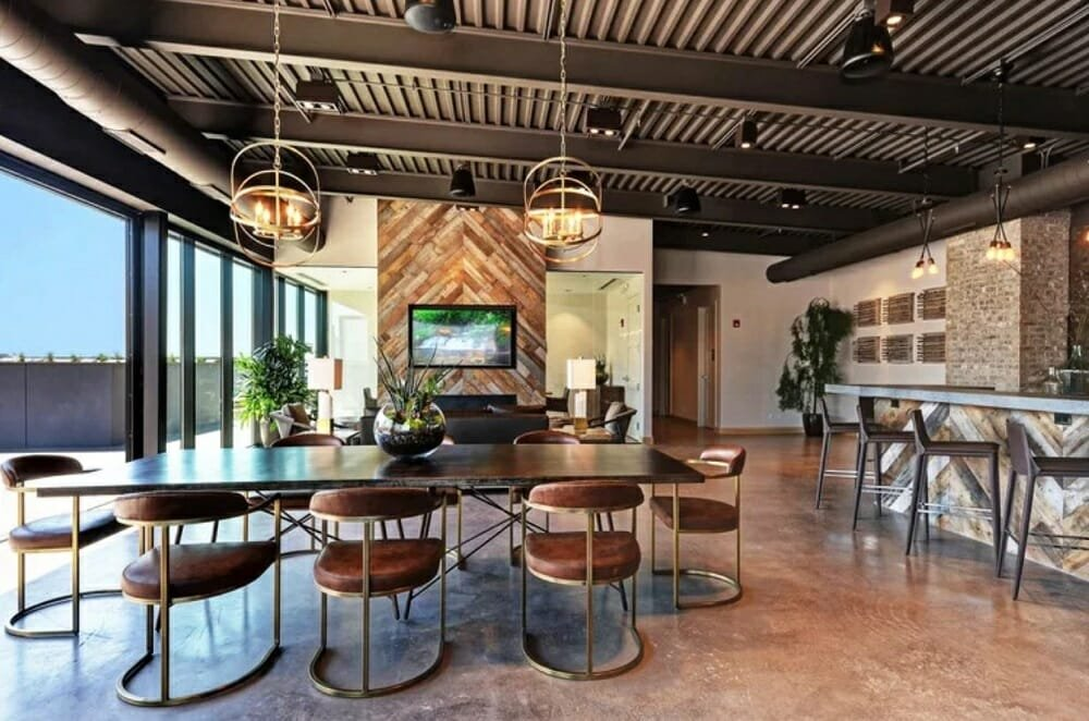 Open living, dining and bar area in brown fall color palettes by Wanda P