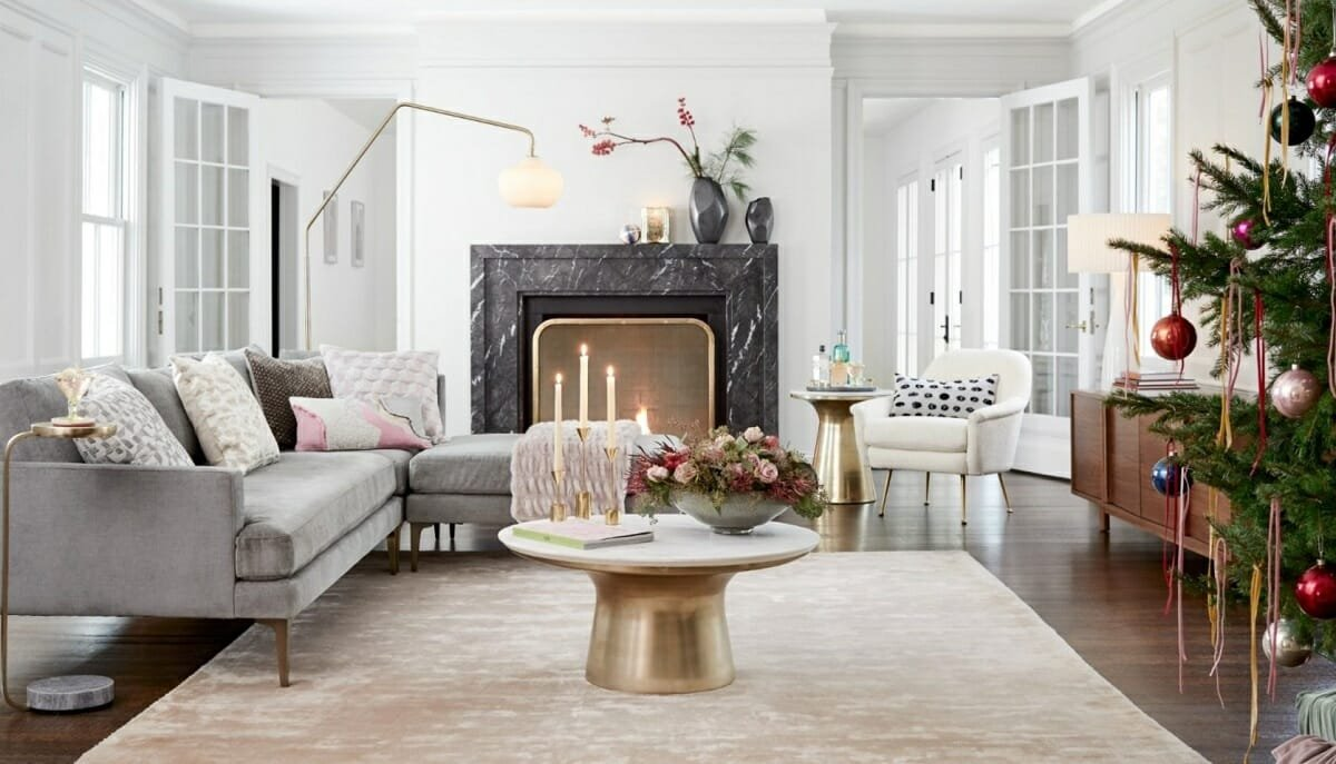 A living room full of interior design presents and luxurious modern furniture and holiday ornaments by West Elm
