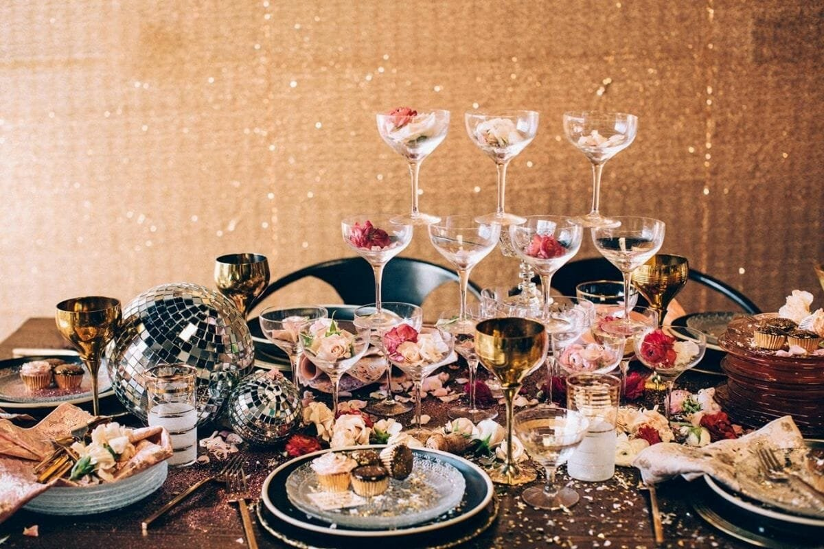 Disco new years centerpiece with champagne glasses