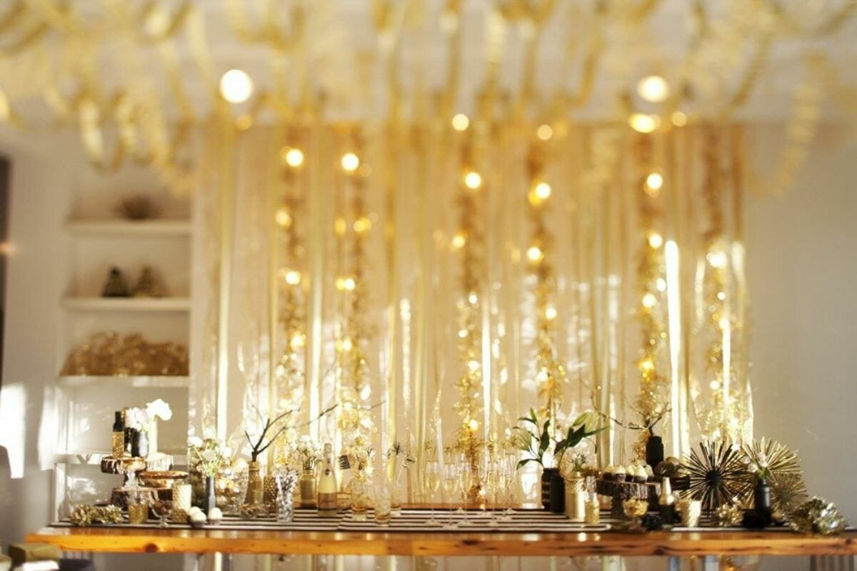 New years wall decorations in gold behind a bar