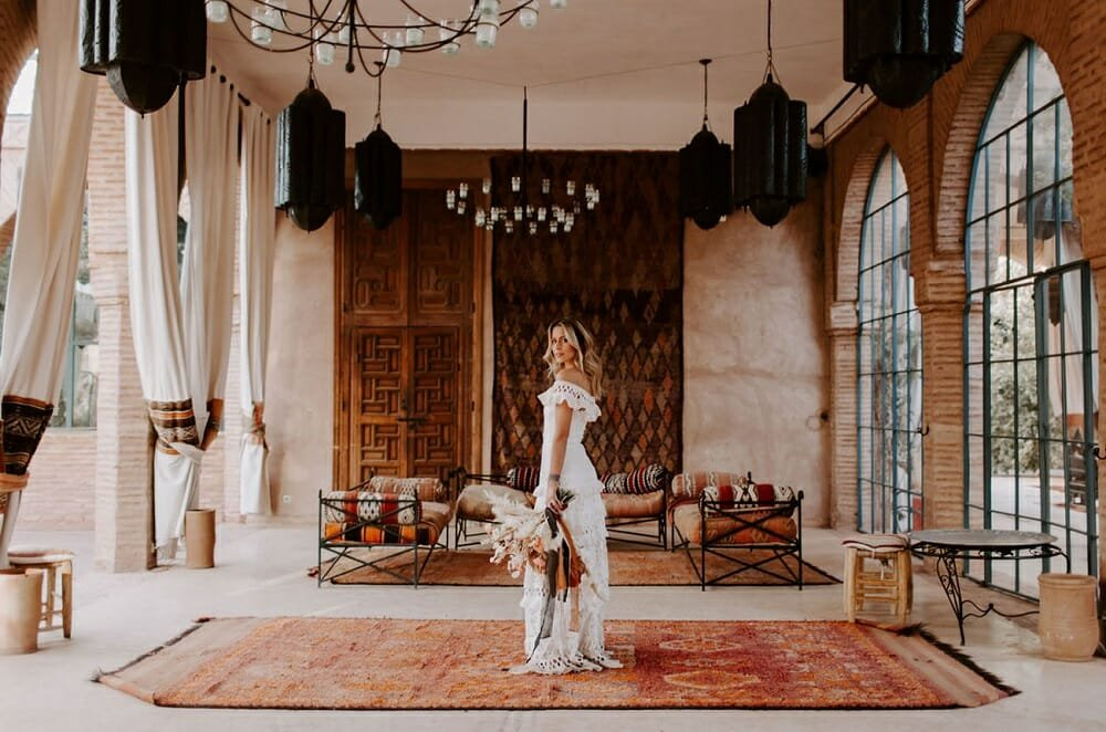 Bride with a bohemian wedding dress style in a Moroccan outdoor lounge