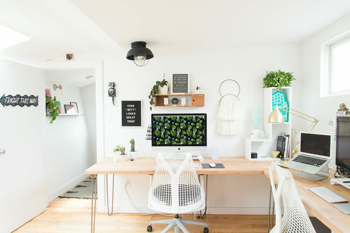 Modern-home-office-with-light-wood-and-plants-as-part-of-creative-employee-incentives-Breanna