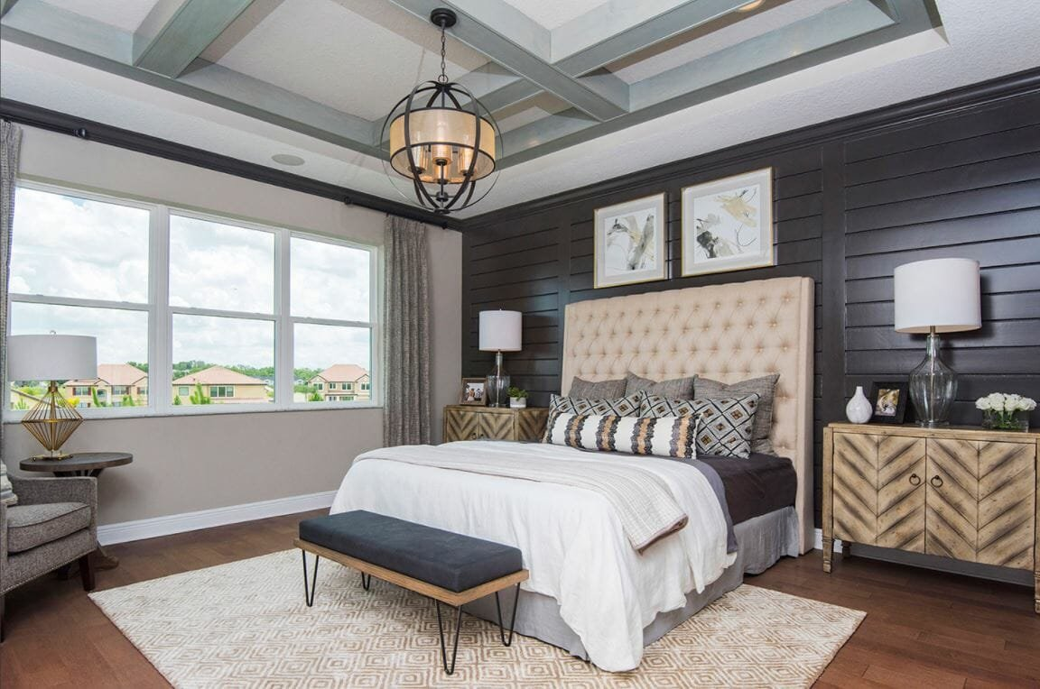 transitional small guest bedroom with wood panel backsplash - masterpiece interiors