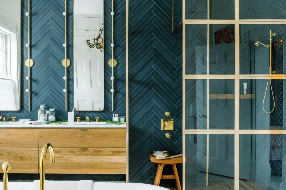 2021 bathroom trends with teal bathroom tiles and gold fixtures