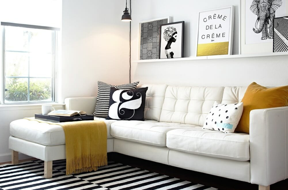 Floating shelves in a black and white lounge - tips on how to make a room look bigger