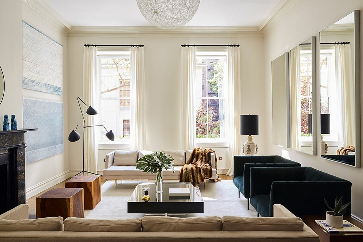 How to make a small room look bigger - bring furniture off the walls