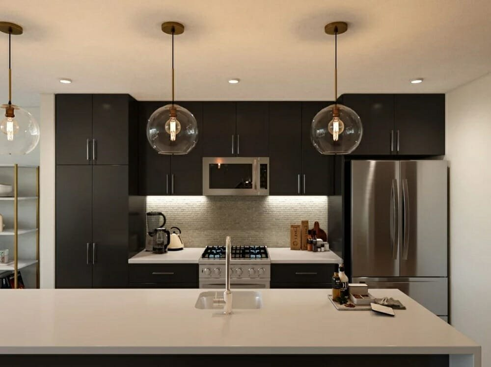 Modern open concept kitchen with black cabinets