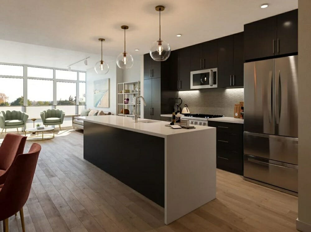 Open kitchen and living room with a dining area and black kitchen cabinets