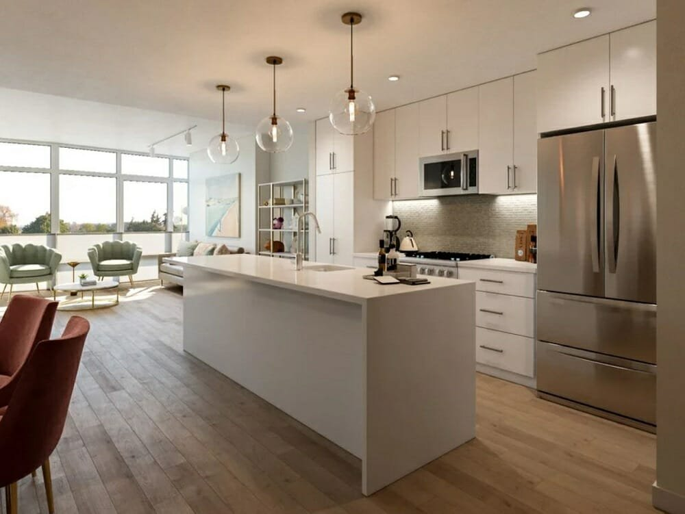 Open kitchen and living room with a dining area and white kitchen cabinets