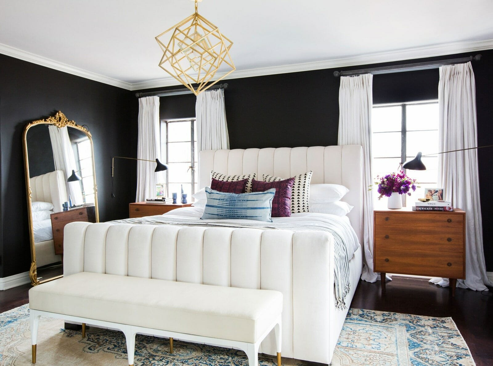 Bold black walls for a modern master bedroom layout